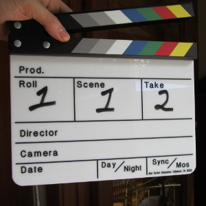 Closeup of film production slate with color clapper sticks