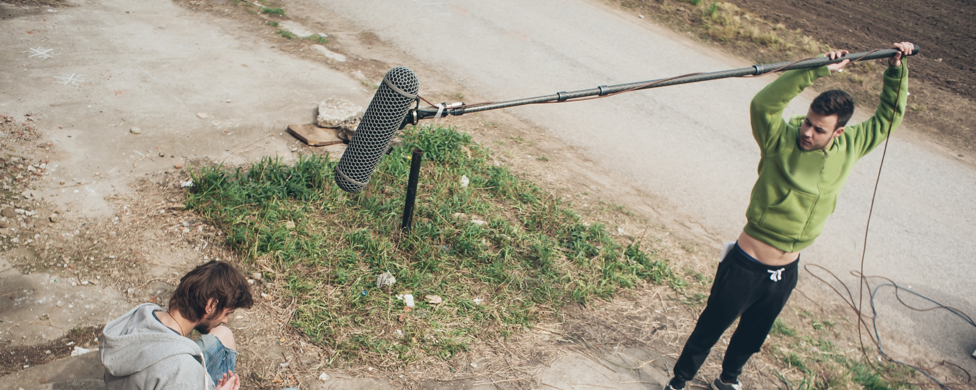 Location sound recordist recording exterior audio